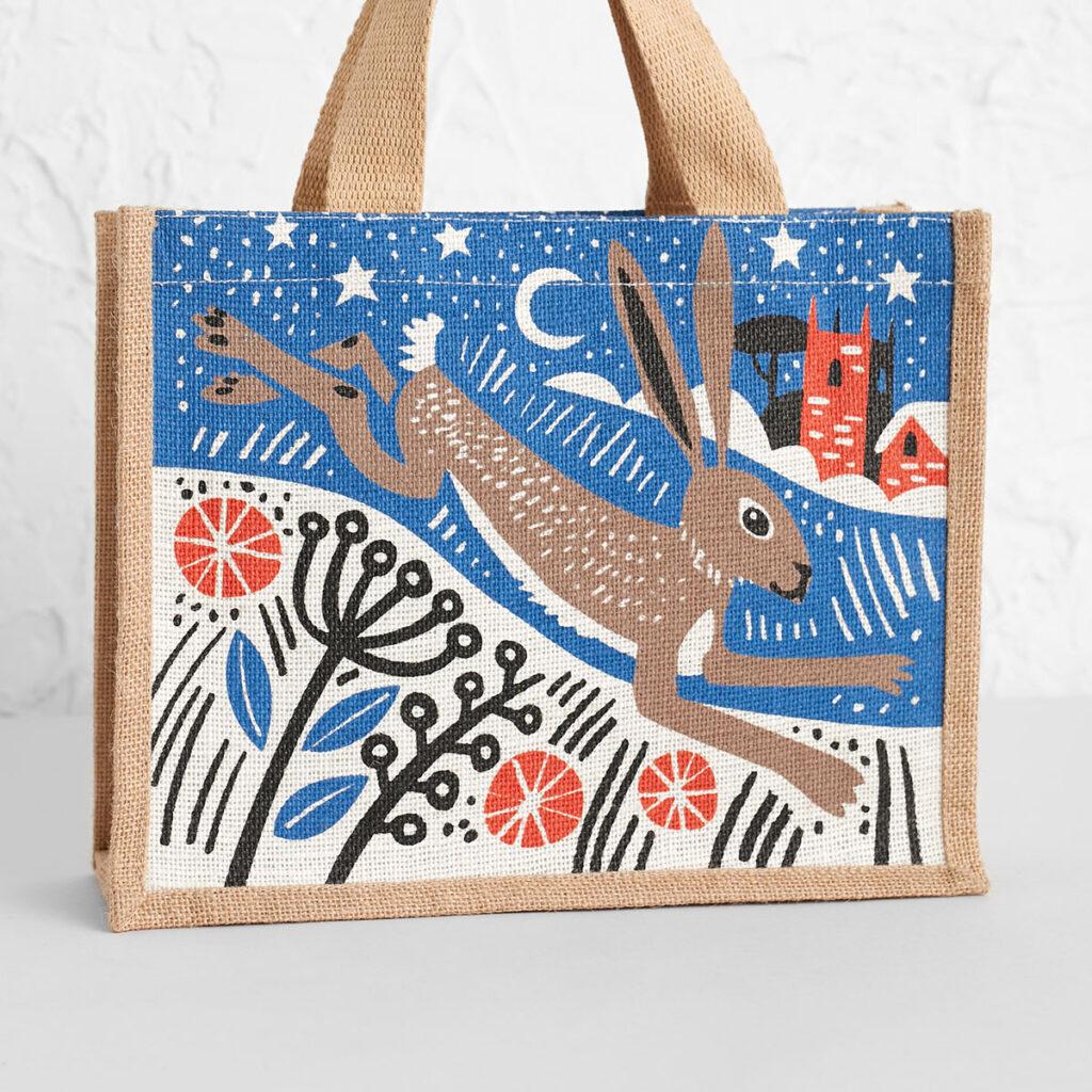 Winter hare jute tote bag by Matt Johnson